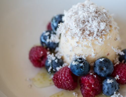 Finger Lime Mousse With Blueberries, Raspberries And Fresh Coconut With Lime Sauce